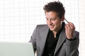 Asian Caucasian mixed race businessman with a laptop computer